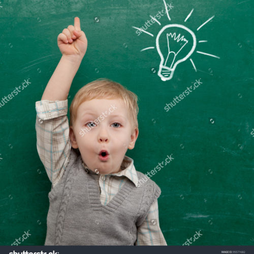 stock-photo-cheerful-smiling-child-at-the-blackboard-school-concept-95571682